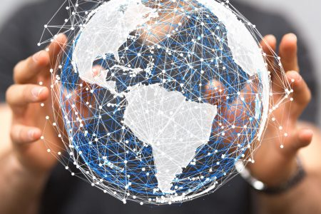 Hands of a man holding a digitized globe close-up
