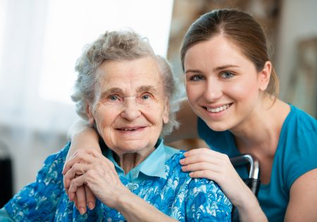Senior woman with her caring relative at home